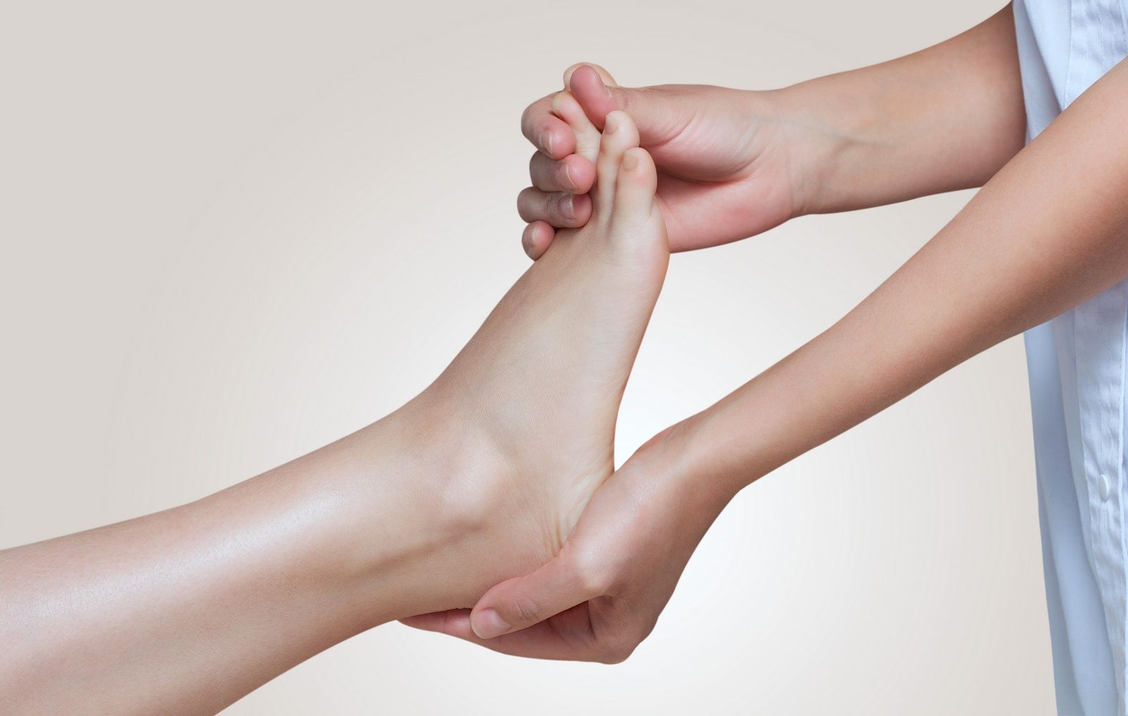 Picture of Podiatrist examining a patient's toes